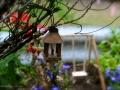 And garden lanterns flicker